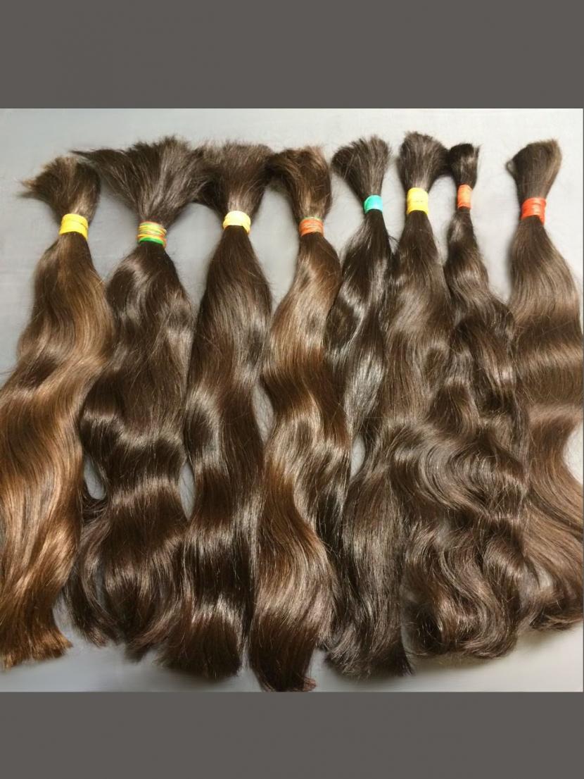 Волосы натуральные славянские коричневые в длине 30-40 см